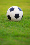 Football  on field of green grass Royalty Free Stock Photo