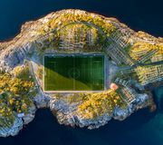 Football field in Henningsvaer from above. Henningsvaer is a fishing village located on several small islands in the Lofoten archipelago in Norway Stock Image