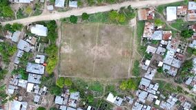 Football field among houses in zanzibar, aerial, topview. Football field sitting among poor houses in a village of zanzibar, tanzania, aerial, topview stock video