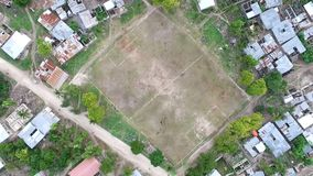 Football field among houses in zanzibar, aerial, topview. Football field sitting among poor houses in a village of zanzibar, tanzania, aerial, topview stock video footage