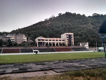 Stadium in Kapan, Armenia. Stadium with many birds royalty free stock photo