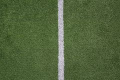 Football field with middle line. Green soccer grass field with white lines closeup. Concept out of play background. The line stands in the middle Stock Photo
