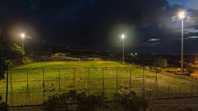 A football field in the night time. Reunion island Stock Photography