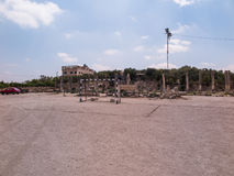 Football field and parking in close proximity to the ruins of an Stock Photography