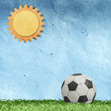 Football on field recycled paper craft Royalty Free Stock Image