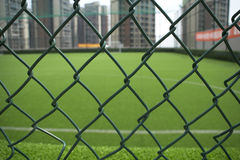 The football field on the roof surrounded by buildings Royalty Free Stock Photography