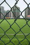 The football field on the roof surrounded by buildings Stock Photography