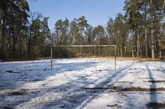 Football field on a snowy field in the forest stock photo