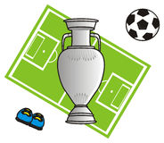 Football field and soccer symbols. Ball and the cup on the background of a football field Stock Photography