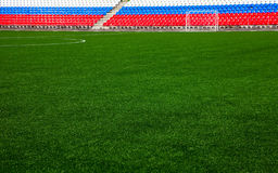 Football field with stands Stock Image