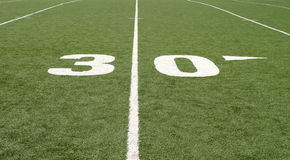 Football Field Thirty. Green football field with large yard numbers Royalty Free Stock Photos