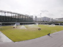 Football field turf water jet curing Stock Image