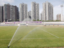 Football field turf water jet curing Stock Photo