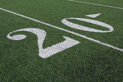 Football Field Twenty Yardline. Closeup view of a football field and the twenty yardline Stock Photo