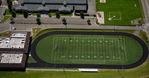 Football Field at Urban High School. Track and field area at a school facility Royalty Free Stock Photo