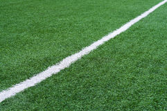 Football field with white stripe. Royalty Free Stock Photo