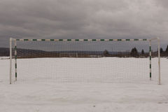 Football field in winter. under the snow Royalty Free Stock Image