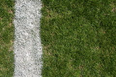Football field yard line. Rough grass and yard line on a football field for sports background Royalty Free Stock Photo