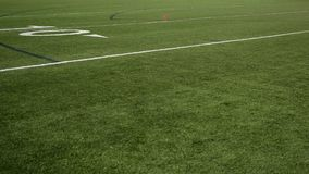 Football Field 10 yard line pan over turf grass