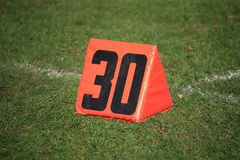 Football Field Yard Marker. Thirty yard line on grass playing field Royalty Free Stock Images