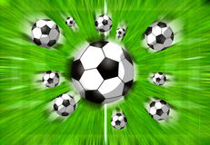 Football filed. With flying balls Royalty Free Stock Photos