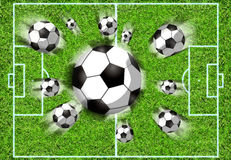 Football filed. With flying balls Royalty Free Stock Images