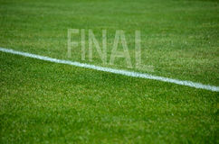 Football final text on grass with white lane Royalty Free Stock Image