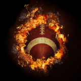 Football on fire. Football on in hot flames fire with black background