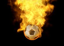 Football on fire. Eye catching you layout with fire burn on soccer ball, It's very interesting to highlight your jobs Royalty Free Stock Photo