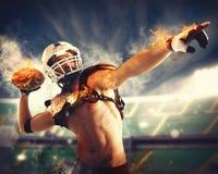 Football fireball. Football player throws a fireball with power royalty free stock photo