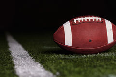 Football on the first down line Royalty Free Stock Photo