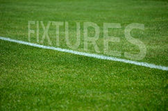 Football fixtures text on grass with white lane Royalty Free Stock Photos