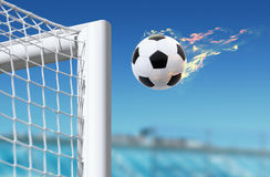 Football flies in goalkeeper gate Royalty Free Stock Image