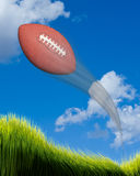 Football in Flight. Royalty Free Stock Photo