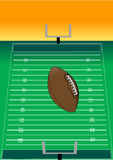 Football flying over field Royalty Free Stock Image
