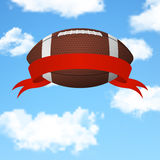 Football flying in the sky. Vector background. Realistic 3d american football ball with red ribbon flying in the sky. Vector EPS10 background Stock Images