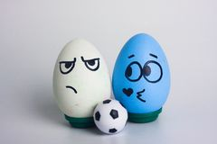 Football and football and homosexual. Football and homosexual. football and soccer ball. victory and defeat in football. funny eggs. blue egg royalty free stock photography