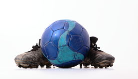 Football and football shoes Stock Photos