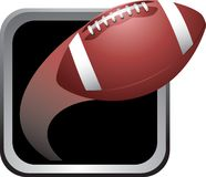 Football frame. Football soaring out of a silver frame Royalty Free Stock Image