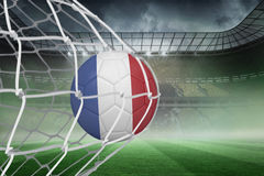Football in france colours at back of net Stock Photos