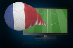 Football in france colours flying out of tv Royalty Free Stock Images