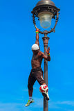 Football Freestyle Iya Traore juggling a Soccer Ball in front of. PARIS, FRANCE - MAY 4, 2014: Incredible Football Freestyle Iya Traore hanging on Lamp Post and stock photos