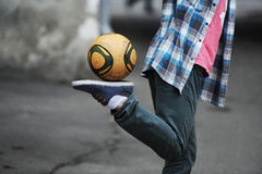 Football freestyle. Performed by the teenager Royalty Free Stock Photos