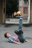 Football freestyle. Performed by the teenager Stock Photography