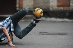 Football freestyle. Performed by the teenager Stock Images