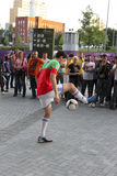 Football freestyler. DONETSK, UKRAINE - JUNE 27, 2012: Unidentified football freestyler before the semi-final match of UEFA EURO 2012 Spain vs. Portugal in Royalty Free Stock Photos