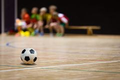 Football Futsal Ball and Youth Team. Indoor Soccer Sports Hall. Children Indoor Soccer Team. Sport Futsal background. Indoor Soccer Winter League for Kids Royalty Free Stock Images