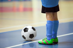 Football futsal training for children. Indoor soccer young player Stock Image