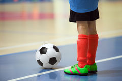 Football futsal training for children. Indoor soccer young player Royalty Free Stock Photos