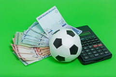 Football Gambling. With Malaysian Ringgit and Calculator Stock Photo